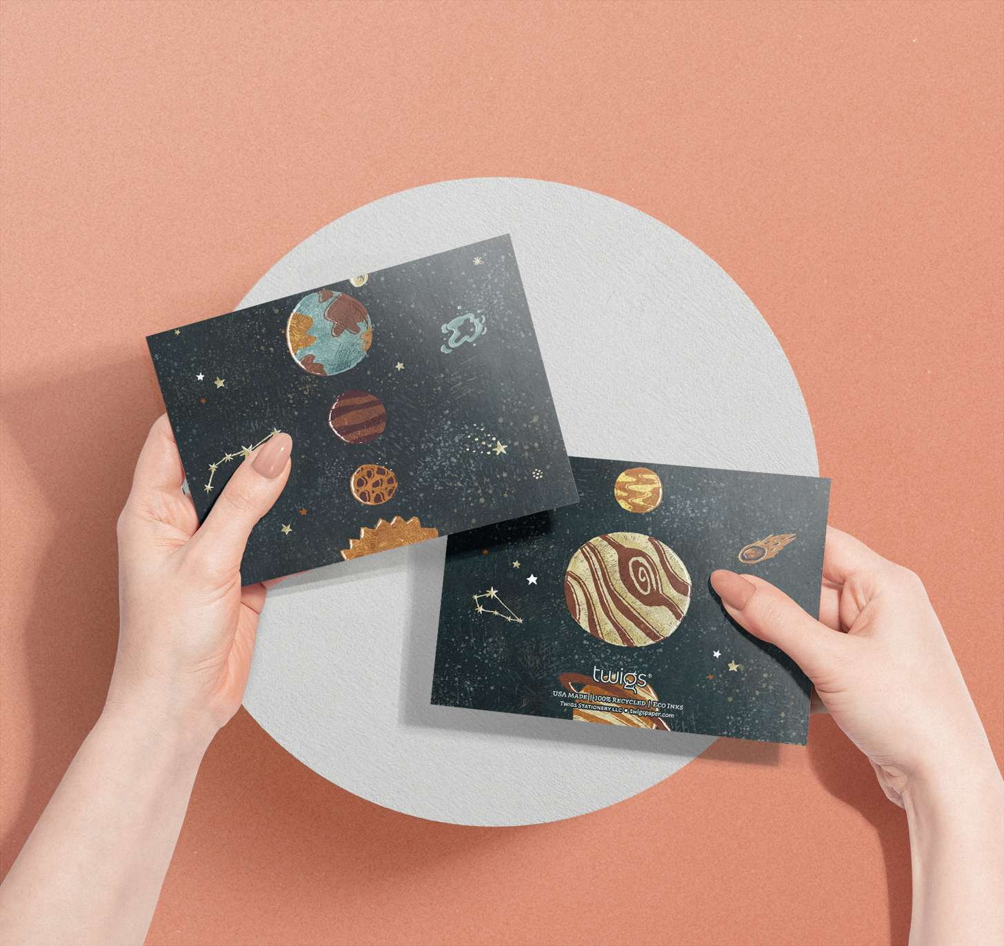 Woman's hand holding solar system planets design card