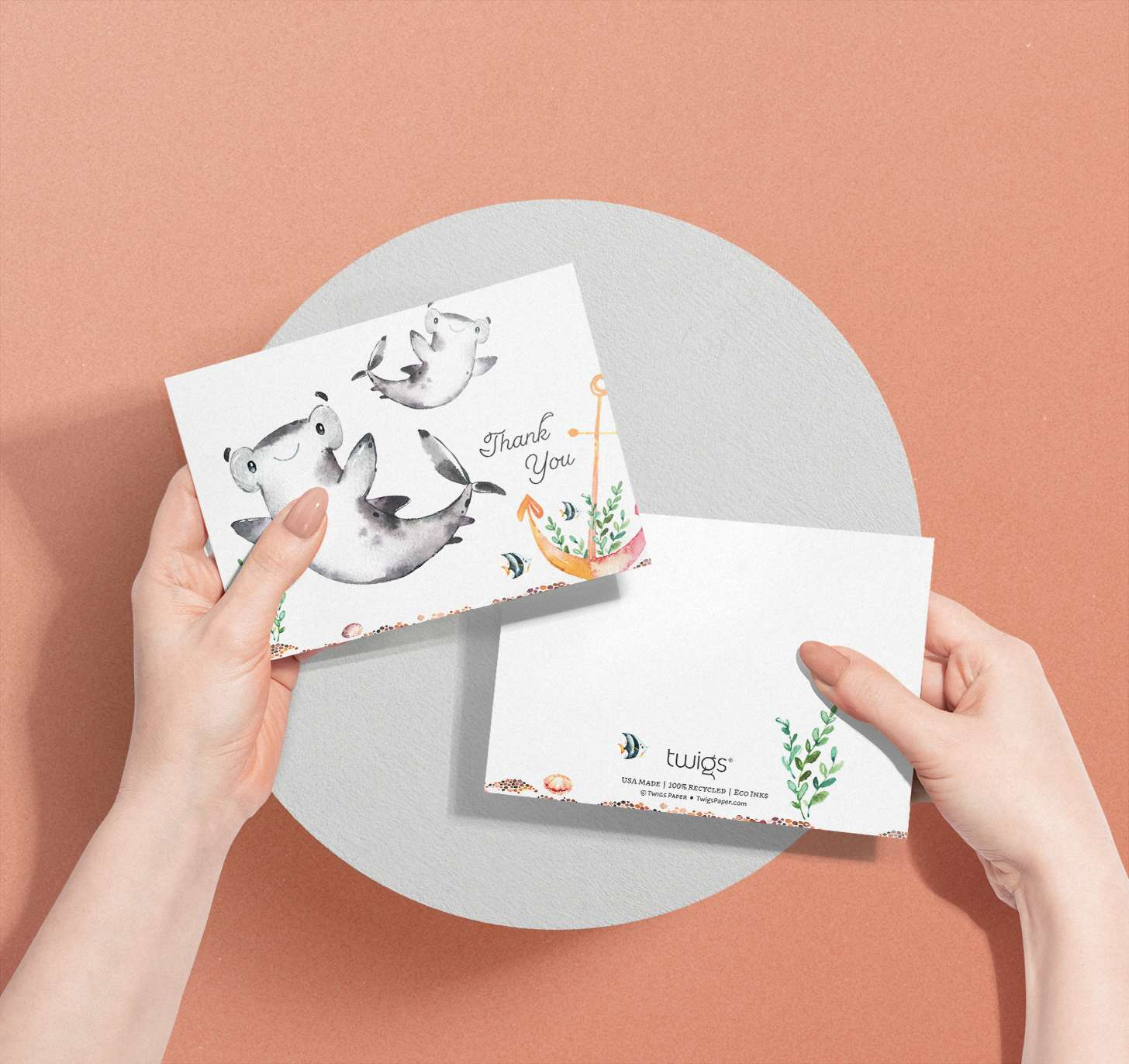 Woman's hands holding Mother and baby shark cards