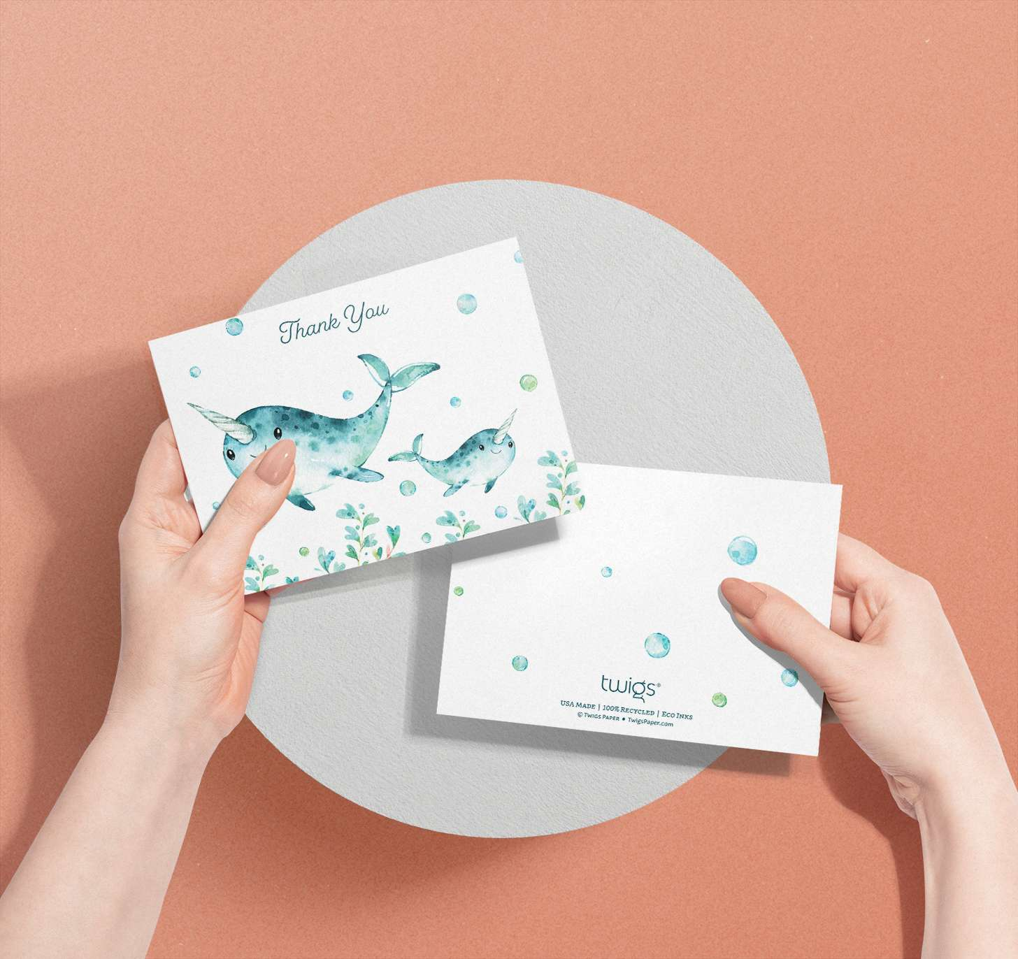 Woman's hands holding Mother and baby blue whale cards with bubbles