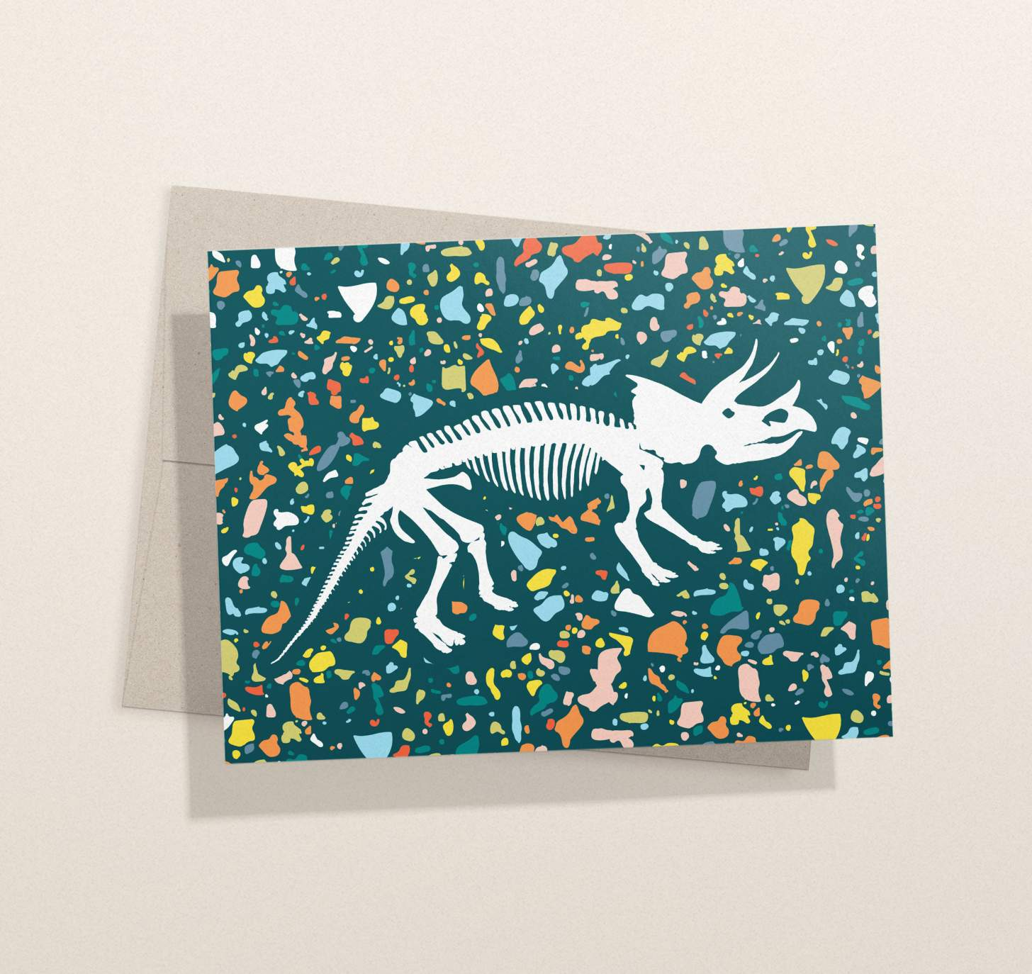 Dinosaur bones design with colorful green background card with envelope