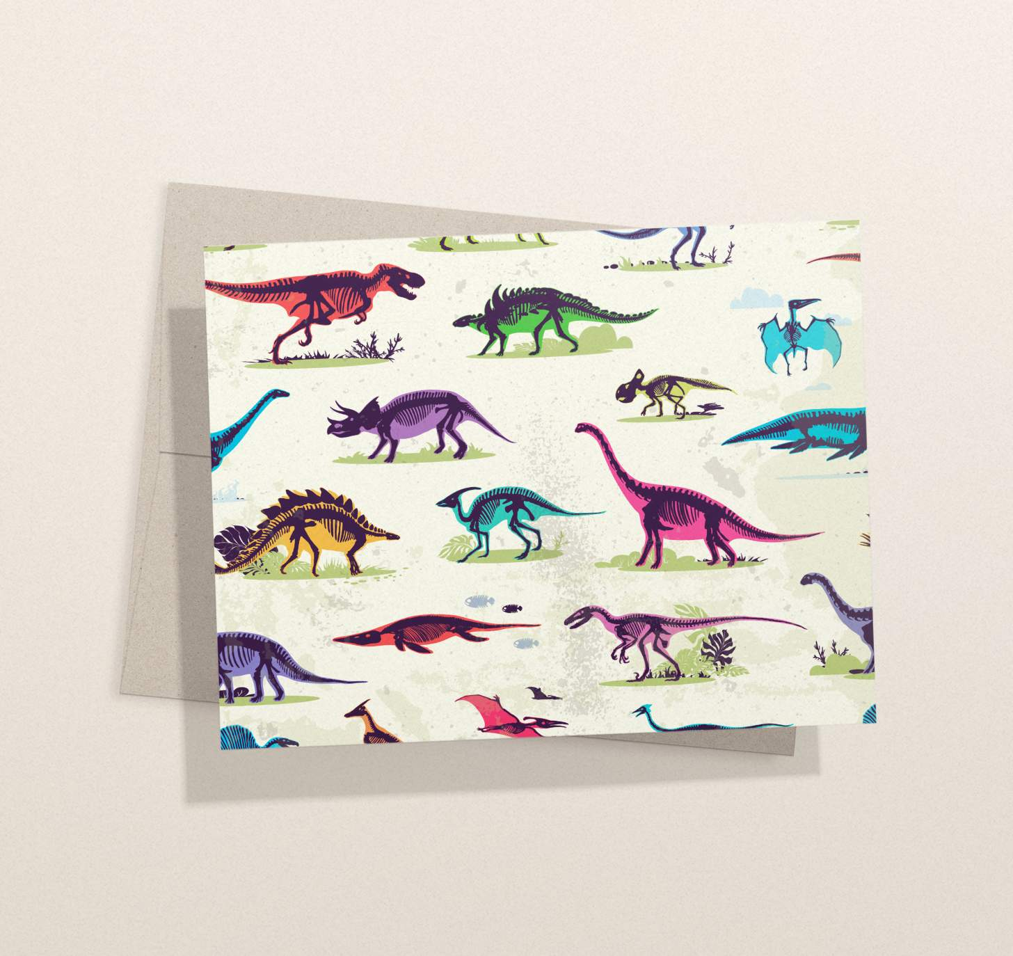 Multicolored dinosaur pattern card with envelope