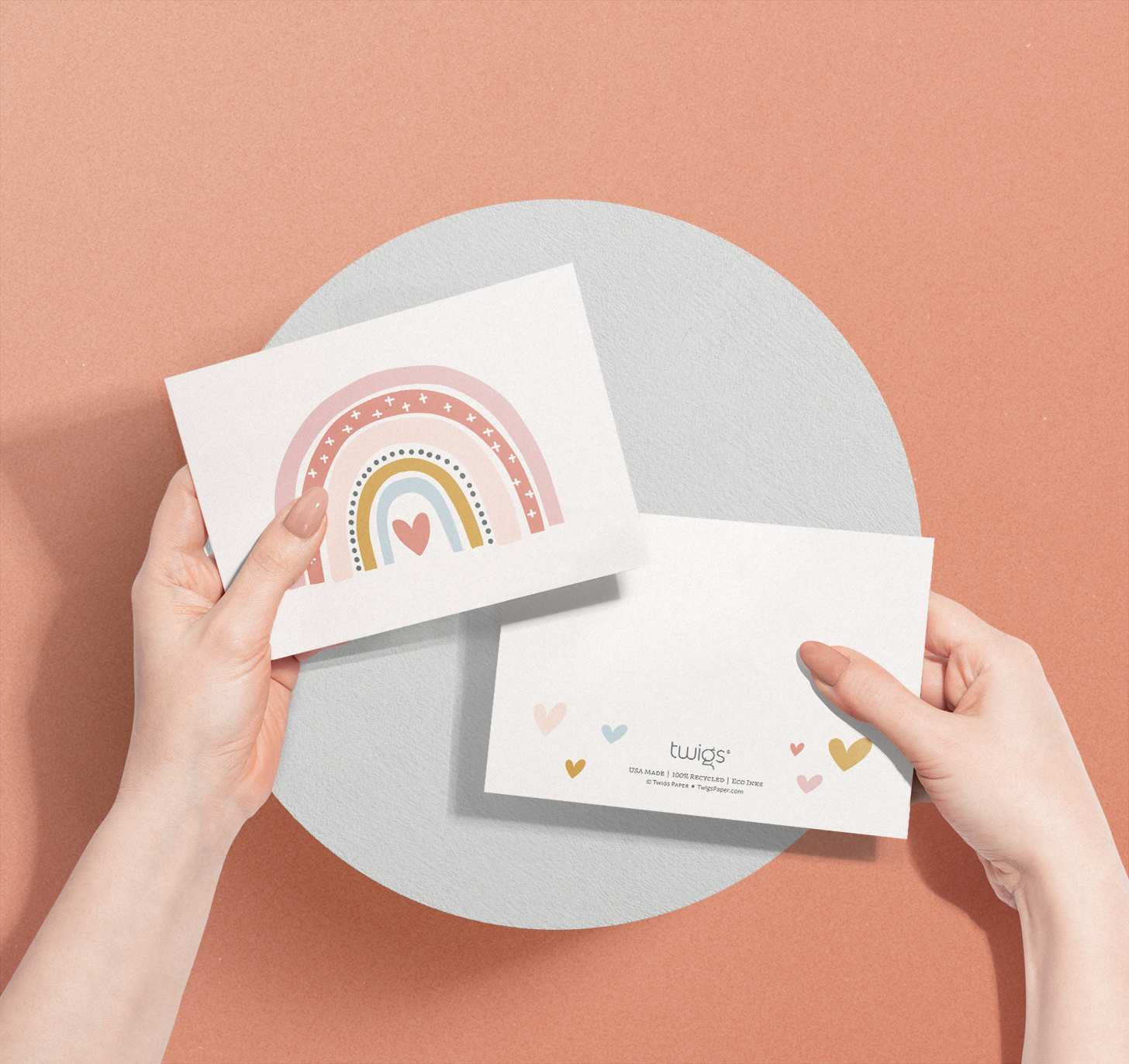 Woman's hands holding Colorful rainbow with heart card