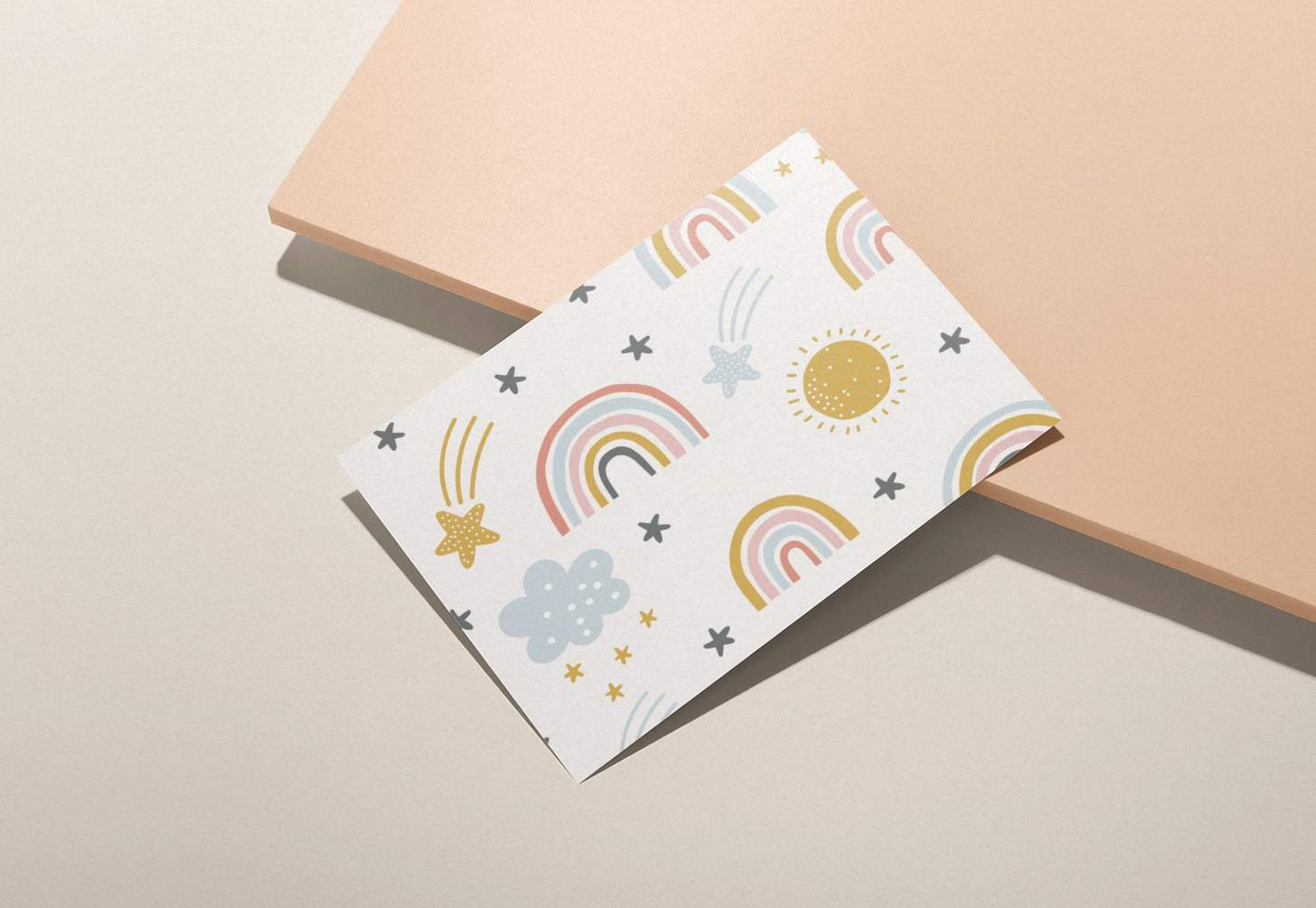 Colorful rainbow, sun, clouds, shooting stars pattern on pink background