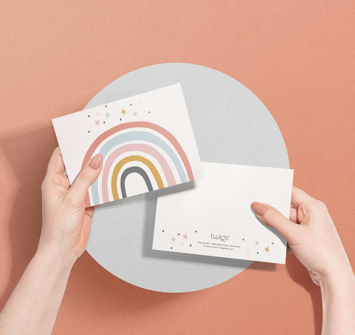 Woman's hands holding Colorful rainbow with stars card