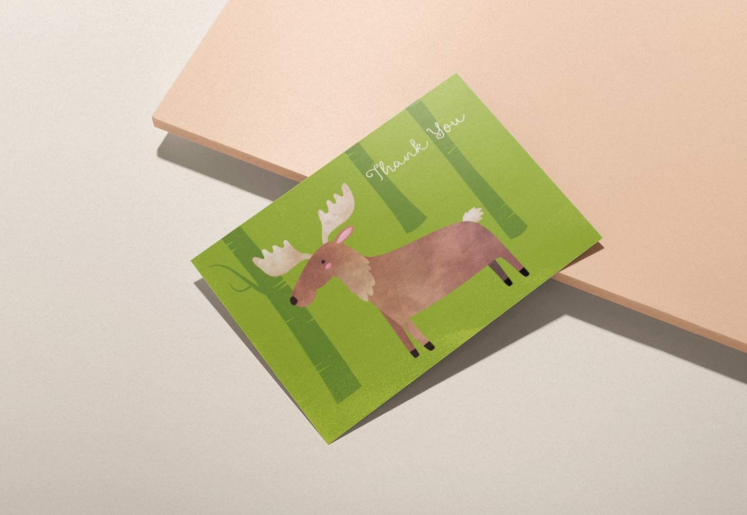 Cute brown moose on green forest design on pink background