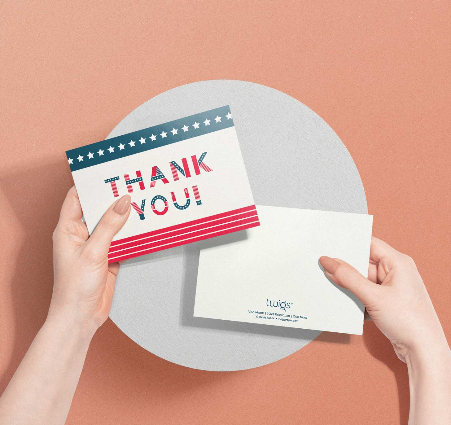 Woman's hand holding card with American flag themed text design
