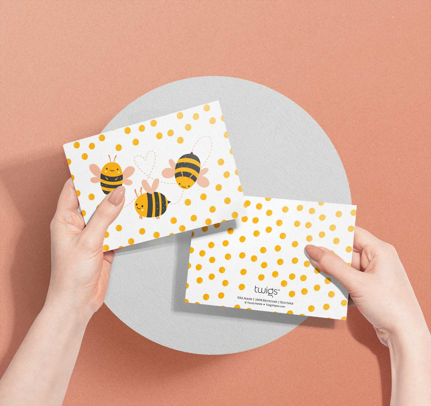 Woman's hands holding bumble bee trio design