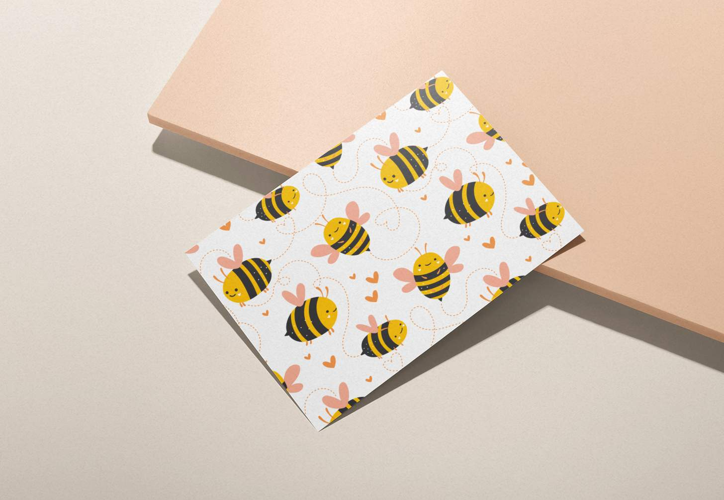 Bumble bees with hearts design card with pink background