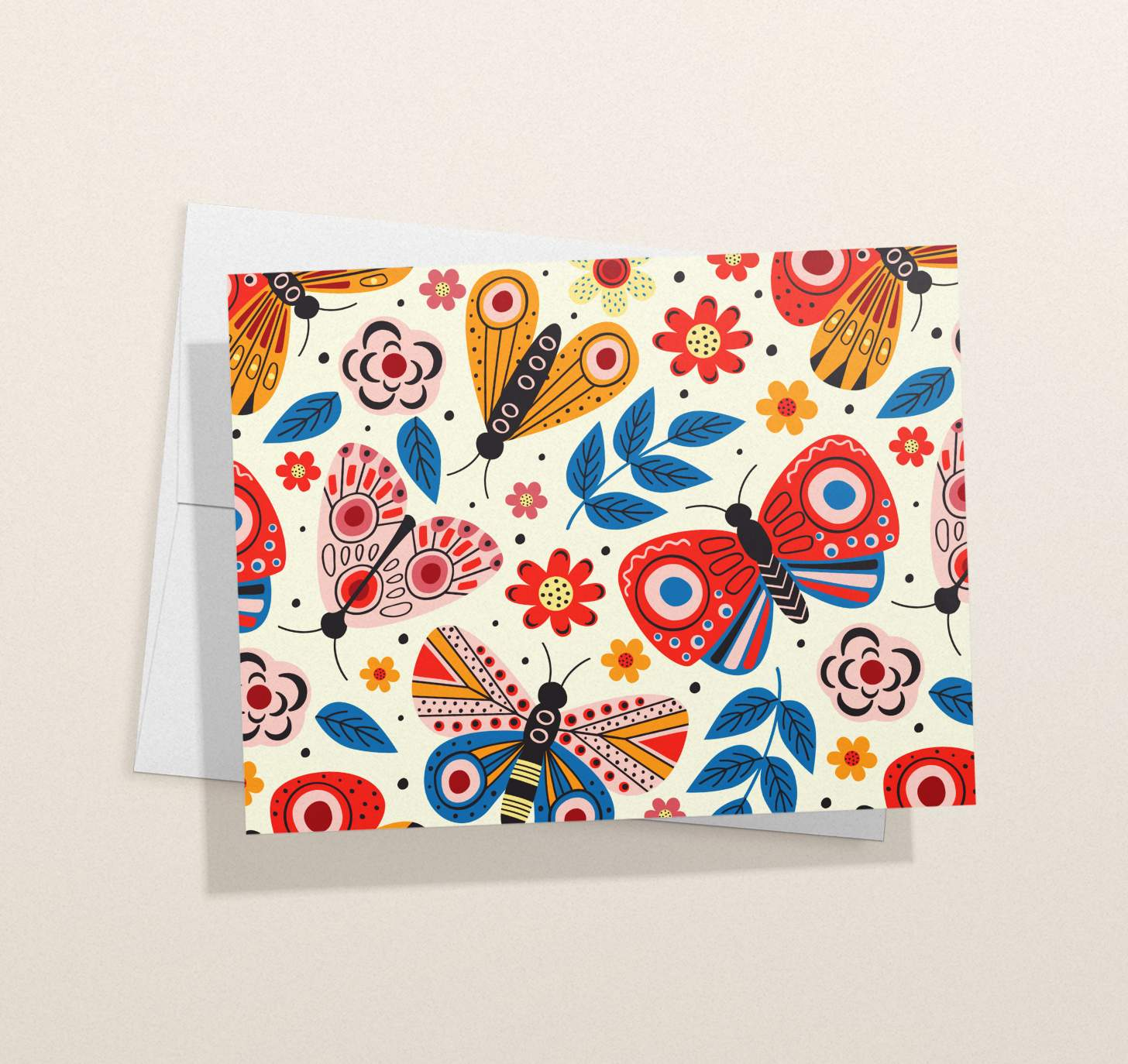 Multicolored butterflies design on white card with envelope