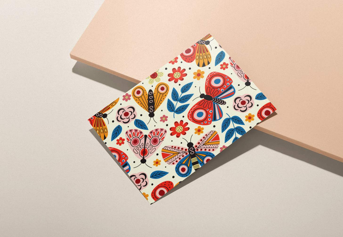 Multicolored butterflies design on white card with pink background