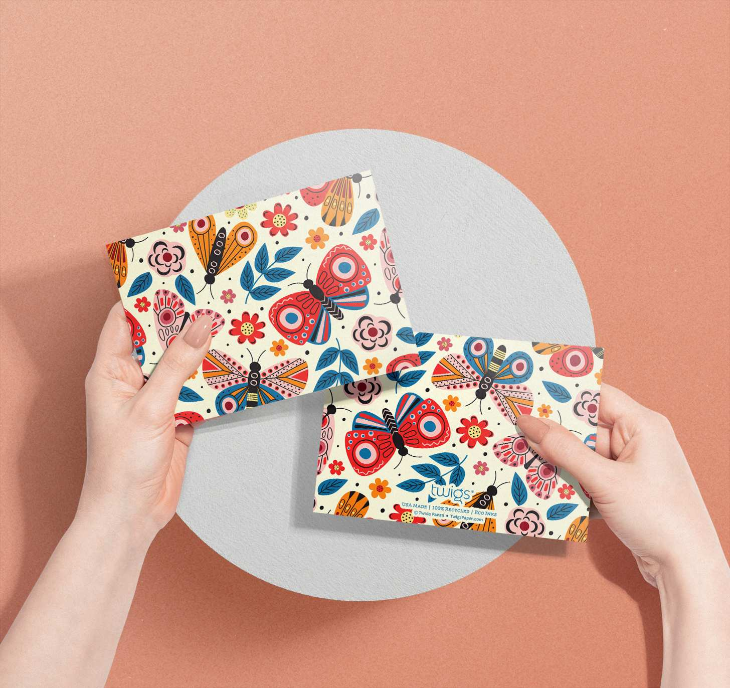 Hands holding Multicolored butterflies design on white card