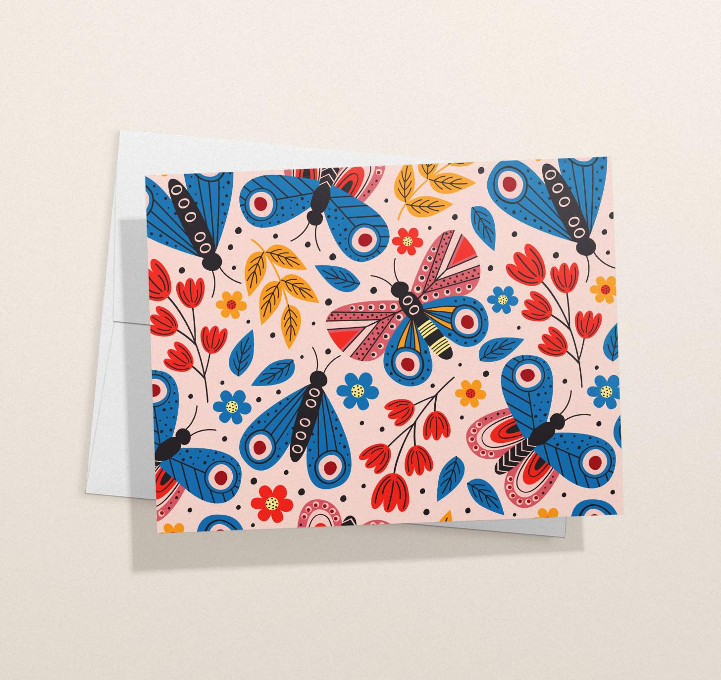 Colorful butterflies design on pink card with envelope