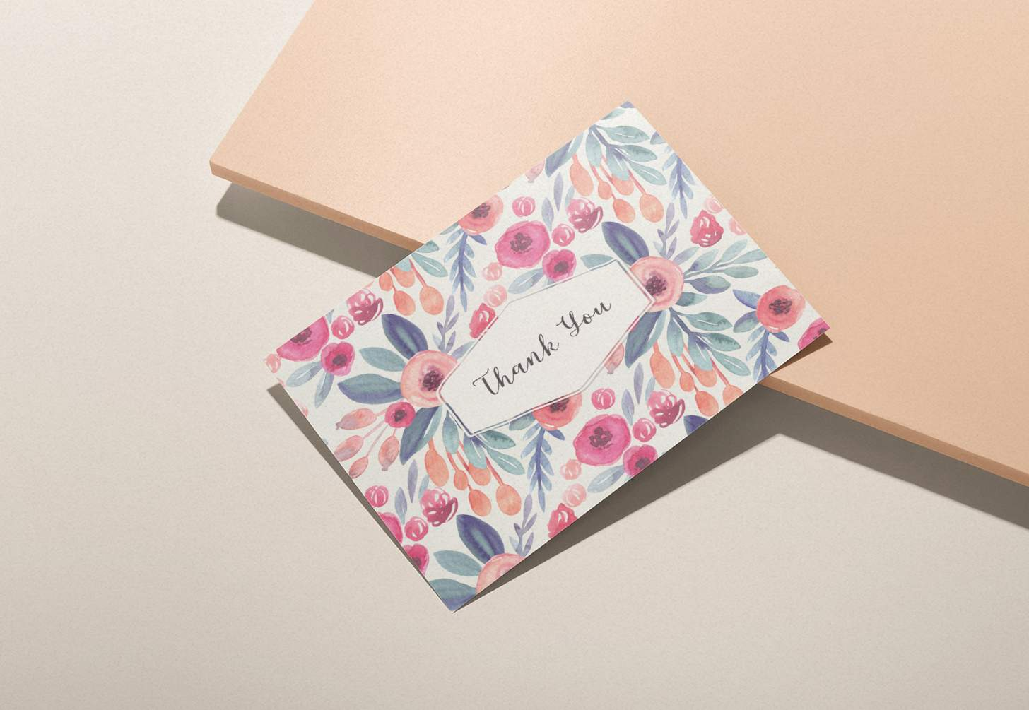 Rose colored floral design thank you card on pink background