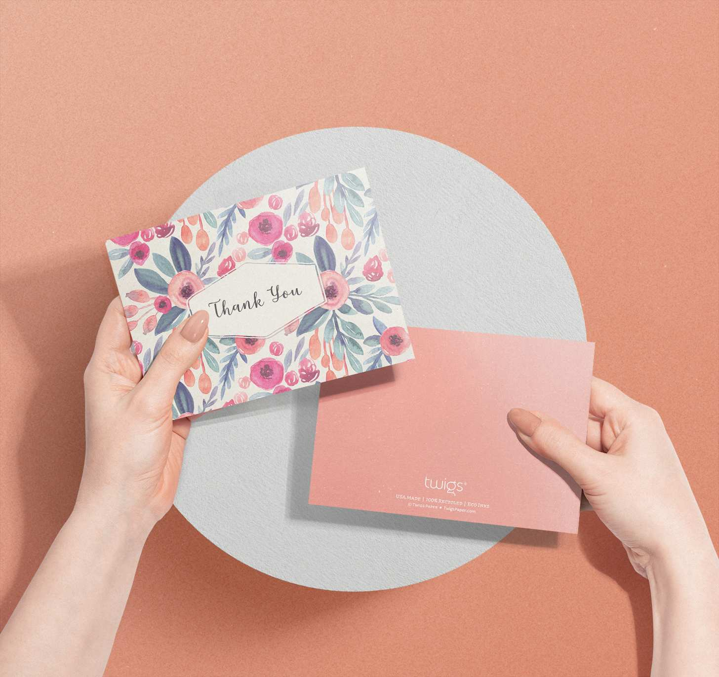 Hands holding Rose colored floral design thank you card