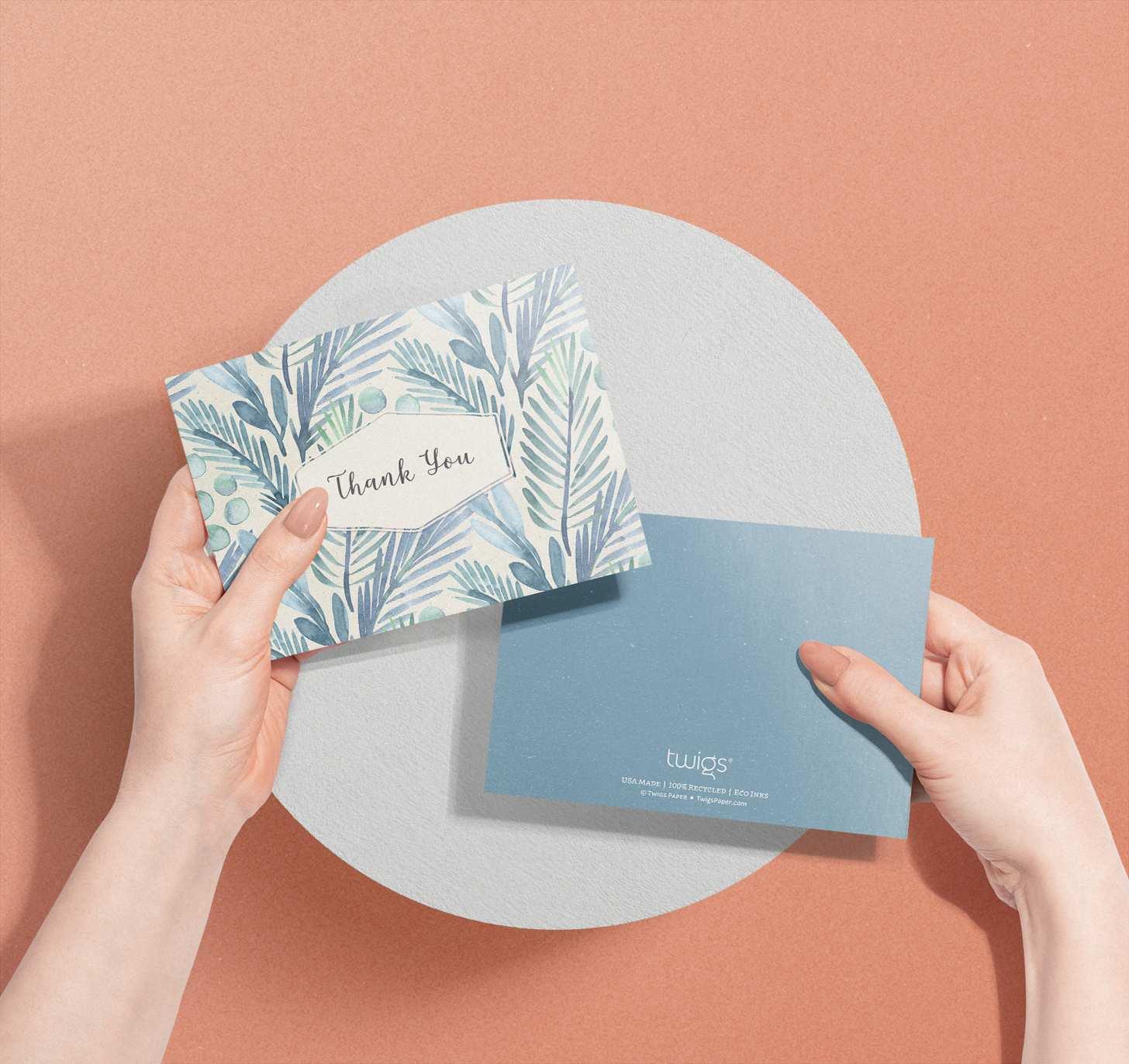 Hands holding Blue floral design thank you card
