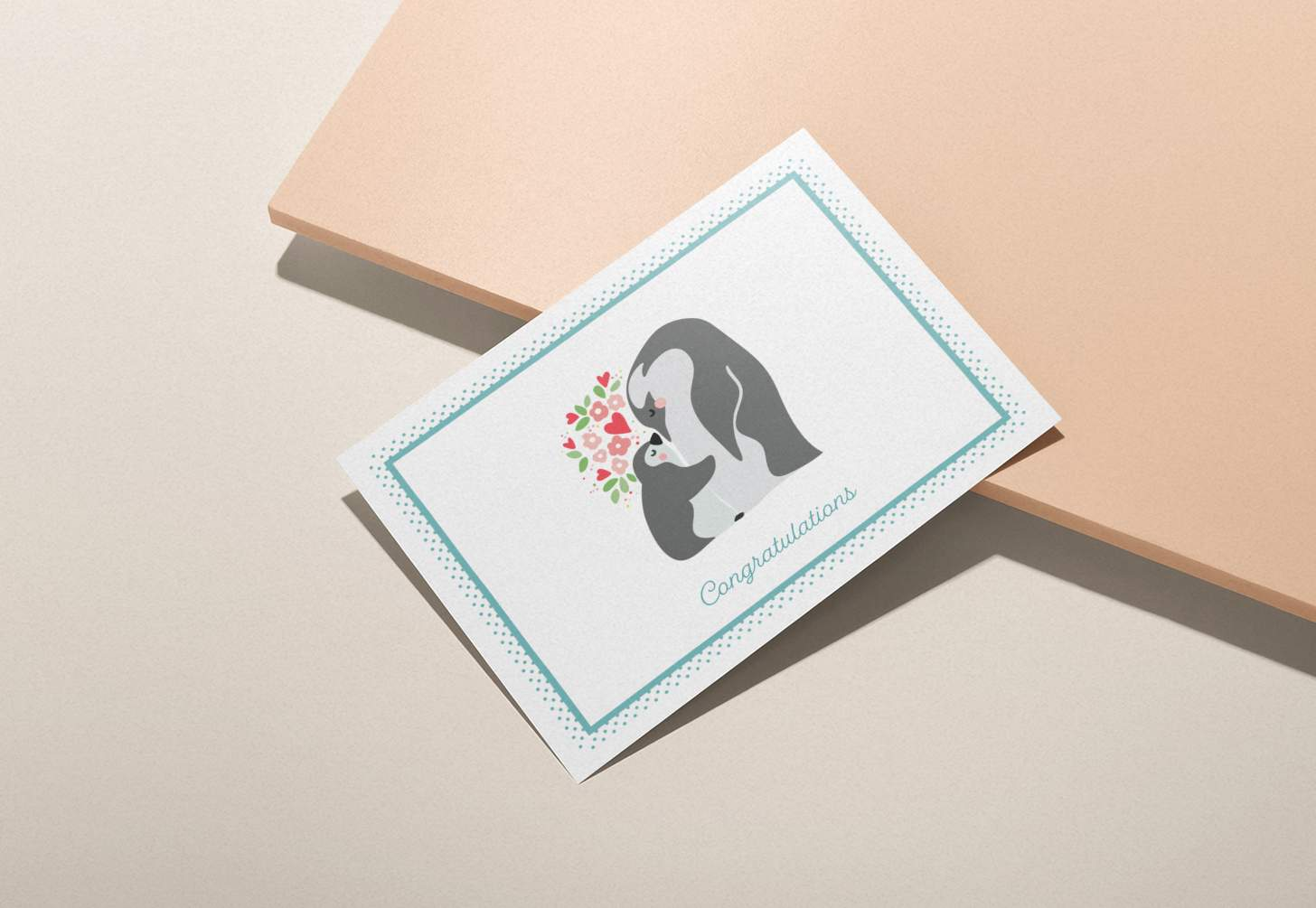 Mother and baby penguin design on a pink background