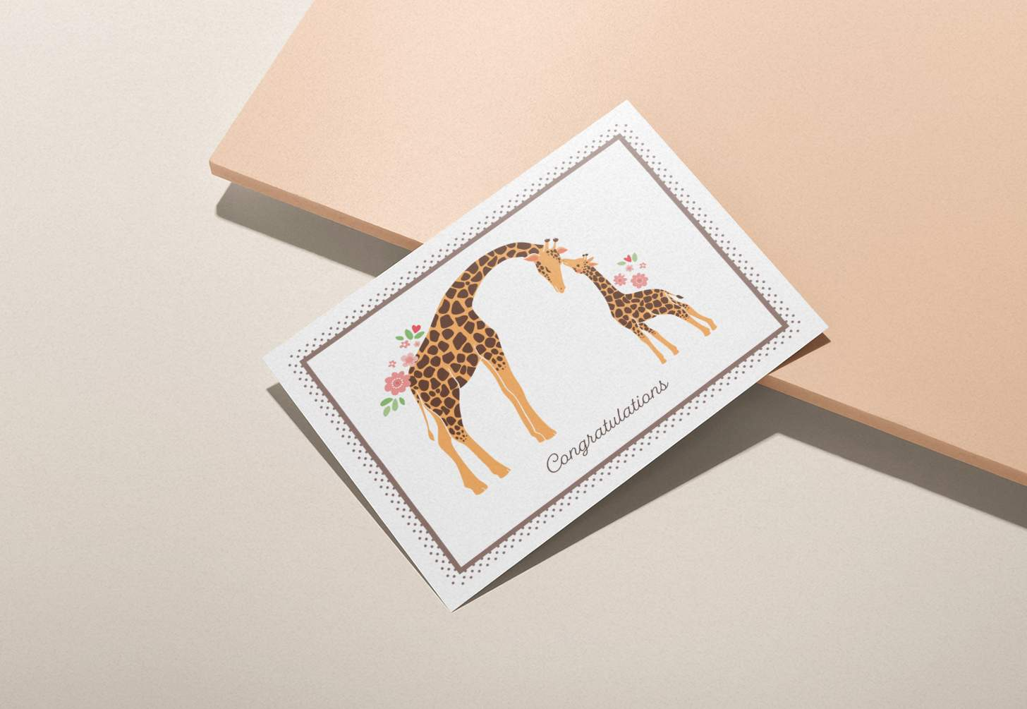 Mother and baby giraffe design on a pink background