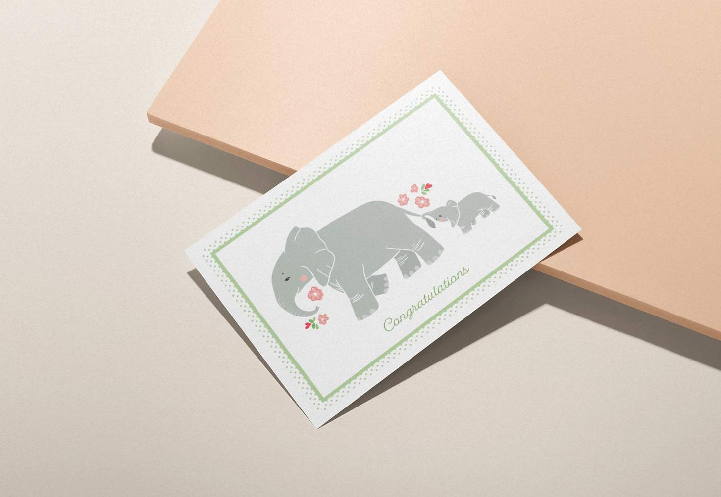 Mother and baby elephant design on pink background