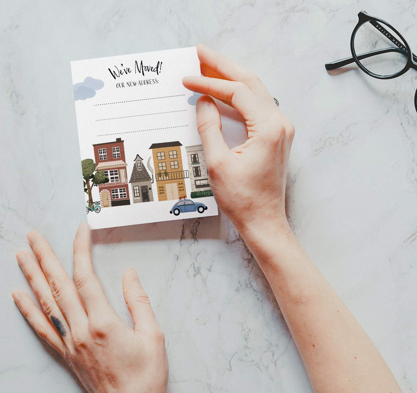 Hand holding city block with car design on marble background