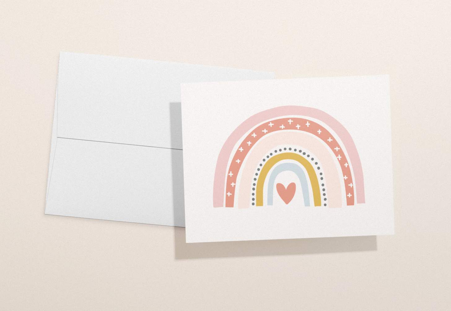 Colorful rainbow with heart card with white envelope