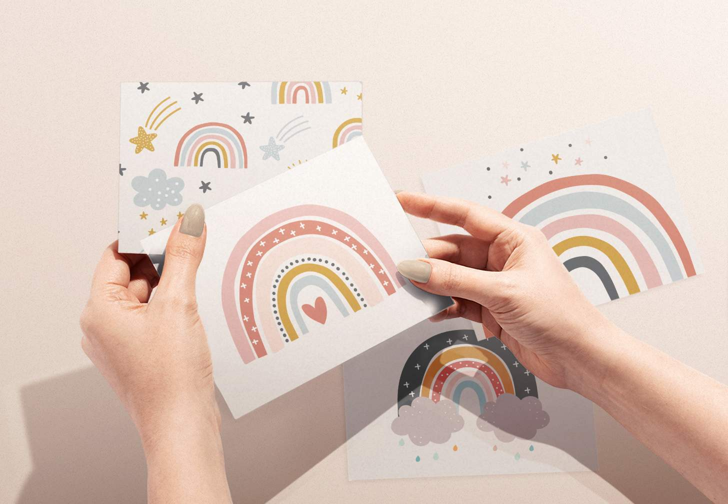 Woman's hand holding colorful rainbow with heart card with various rainbow cards in background