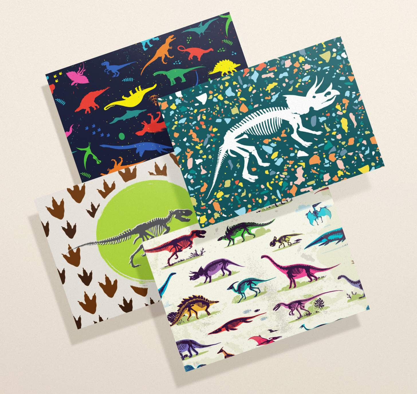 Four overlapping cards featuring dinosaur bones, neon dinosaurs, multicolor dinosaurs, and footprints designs