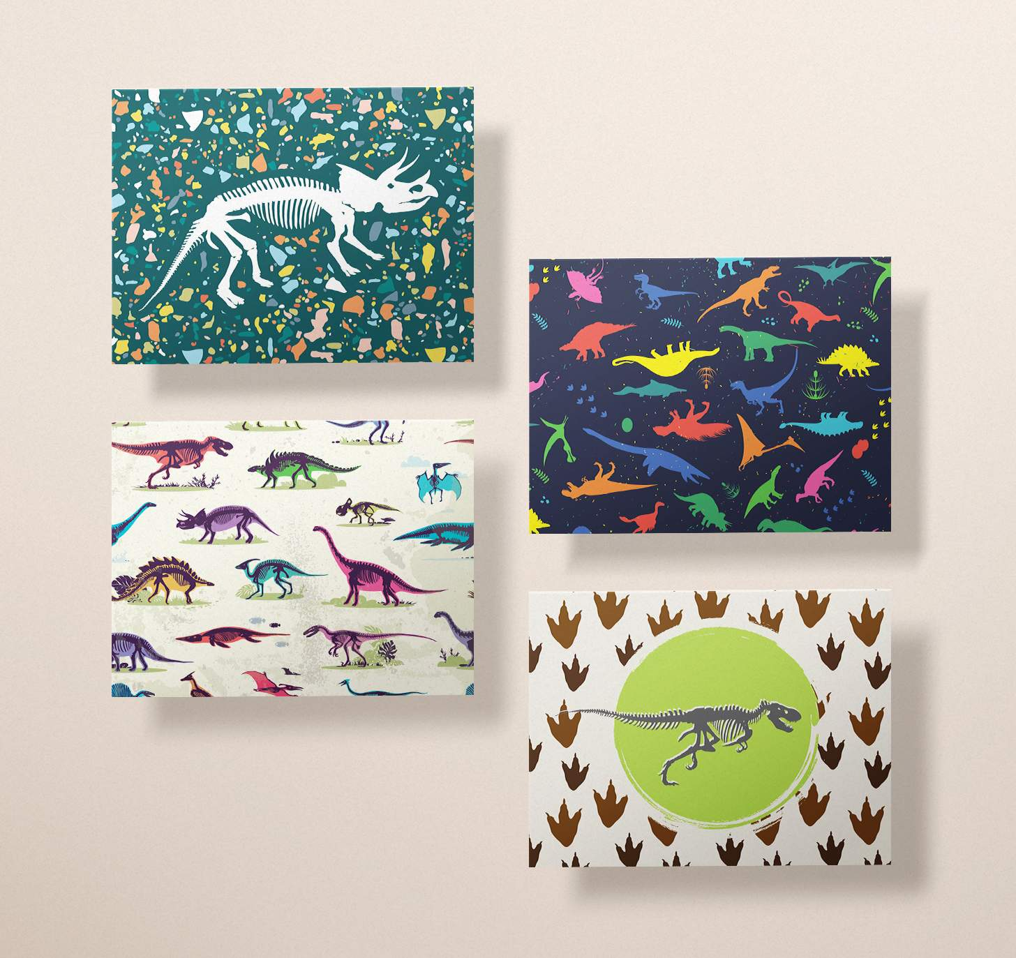Four cards with featuring dinosaur bones, neon dinosaurs, multicolor dinosaurs, and footprints designs