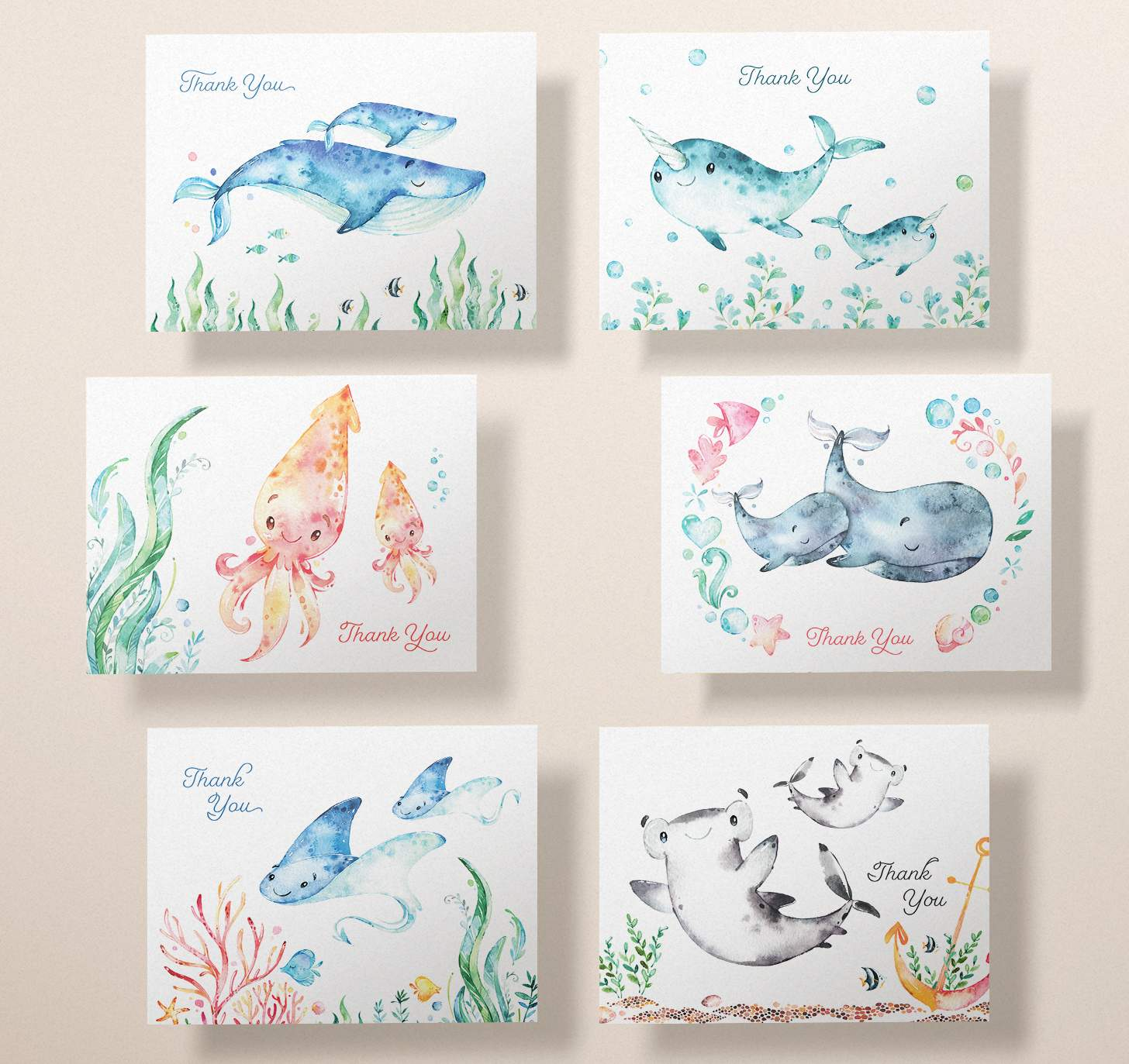 Six cards with mother and baby blue whale, gray whale, narwhal, squid, shark, and sting ray designs