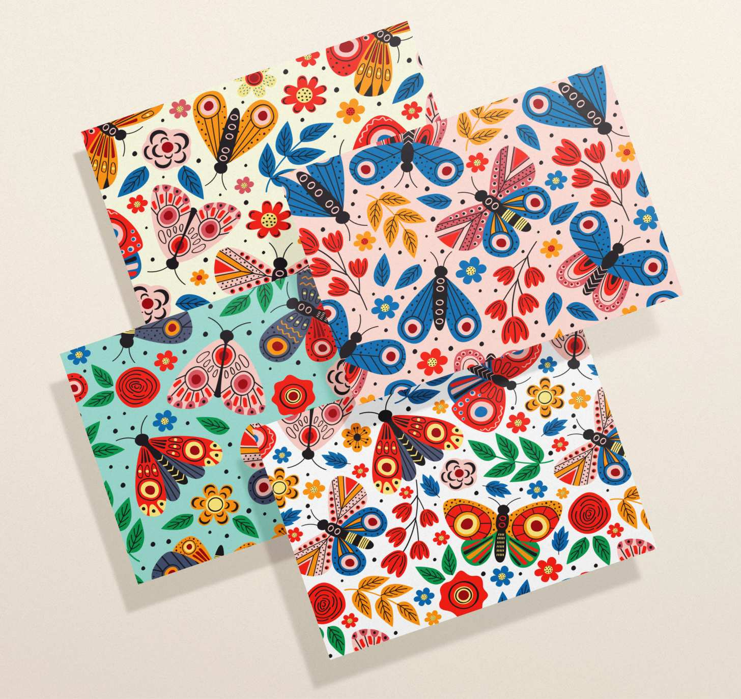Four overlapping assorted multicolored butterfly cards with blue, pink, yellow, and white designs