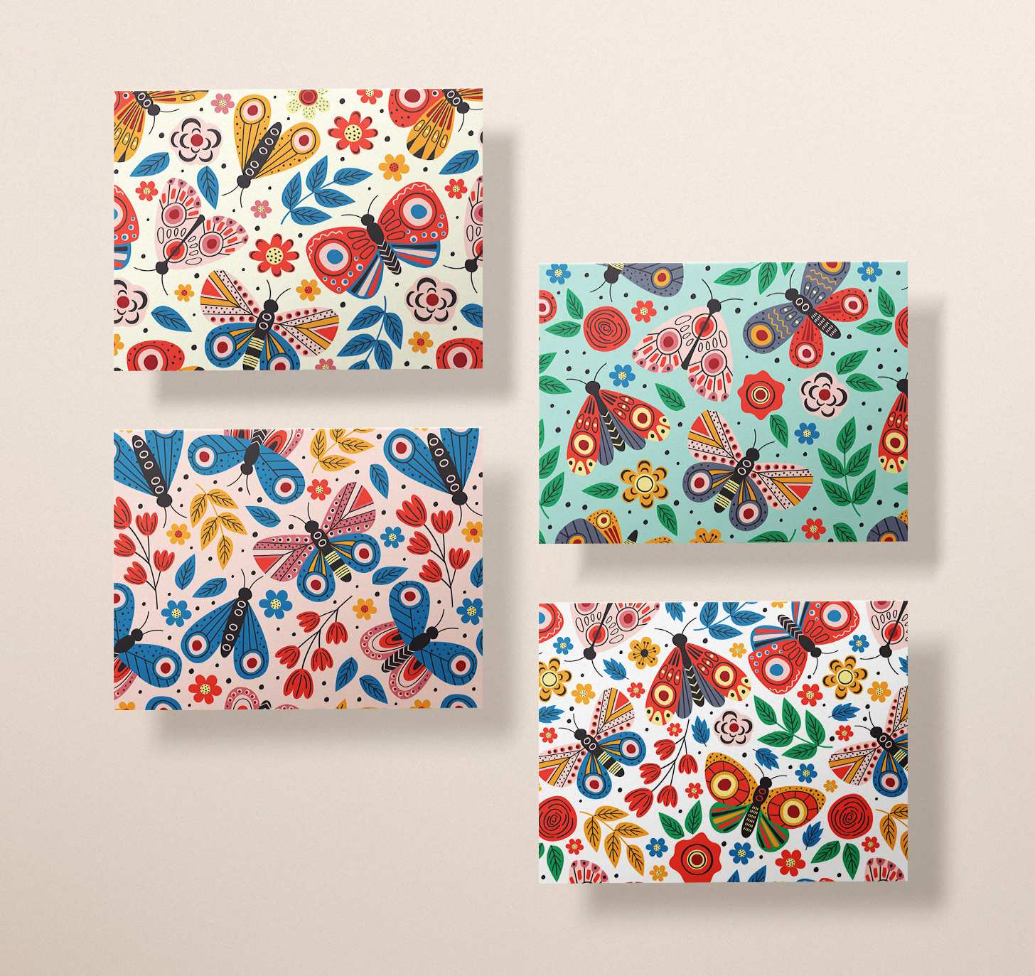 Four assorted multicolored butterfly cards with blue, pink, yellow, and white designs