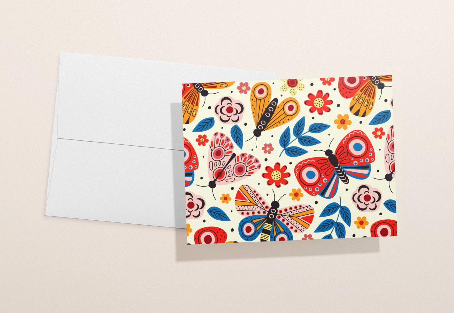 Multicolored butterfly design on white card with white envelope