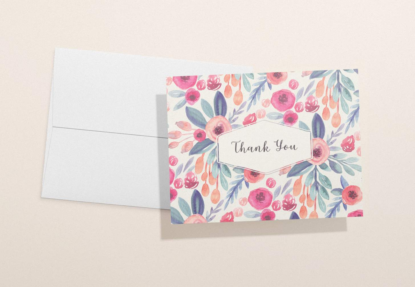 Rose colored floral card with white envelope
