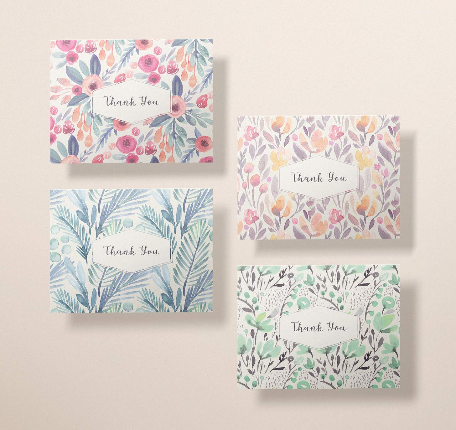 Four assorted cards with blue, green, pink, and rose color designs