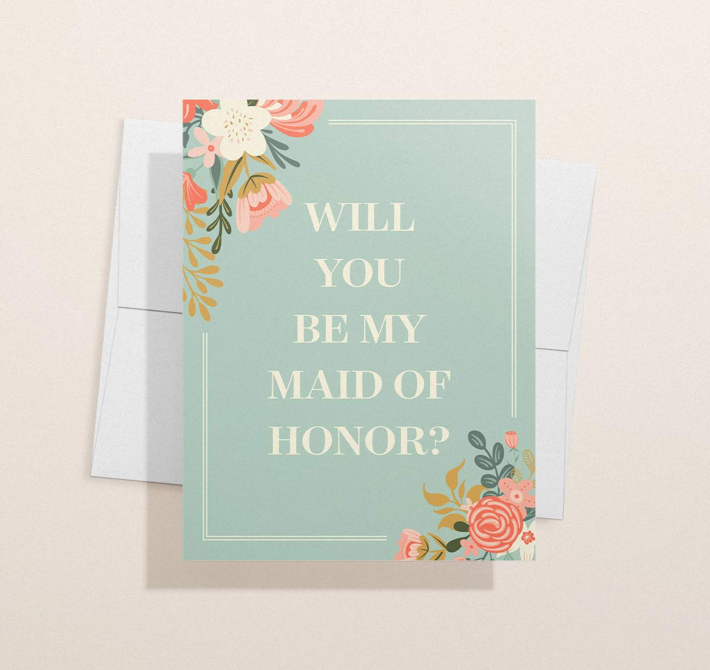 Green card with pink and white flowers design with envelope