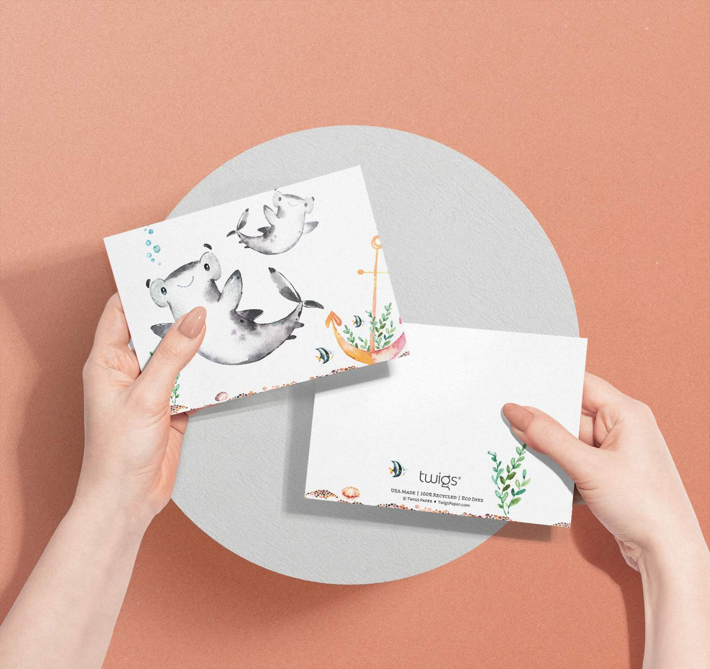 Woman's hands holding Mother and baby shark cards with tropical fish
