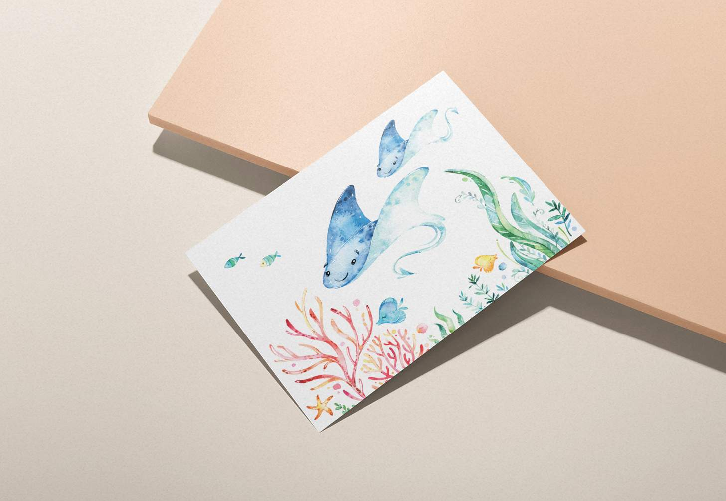 Mother and baby blue sting ray design with tropical fish on a pink background
