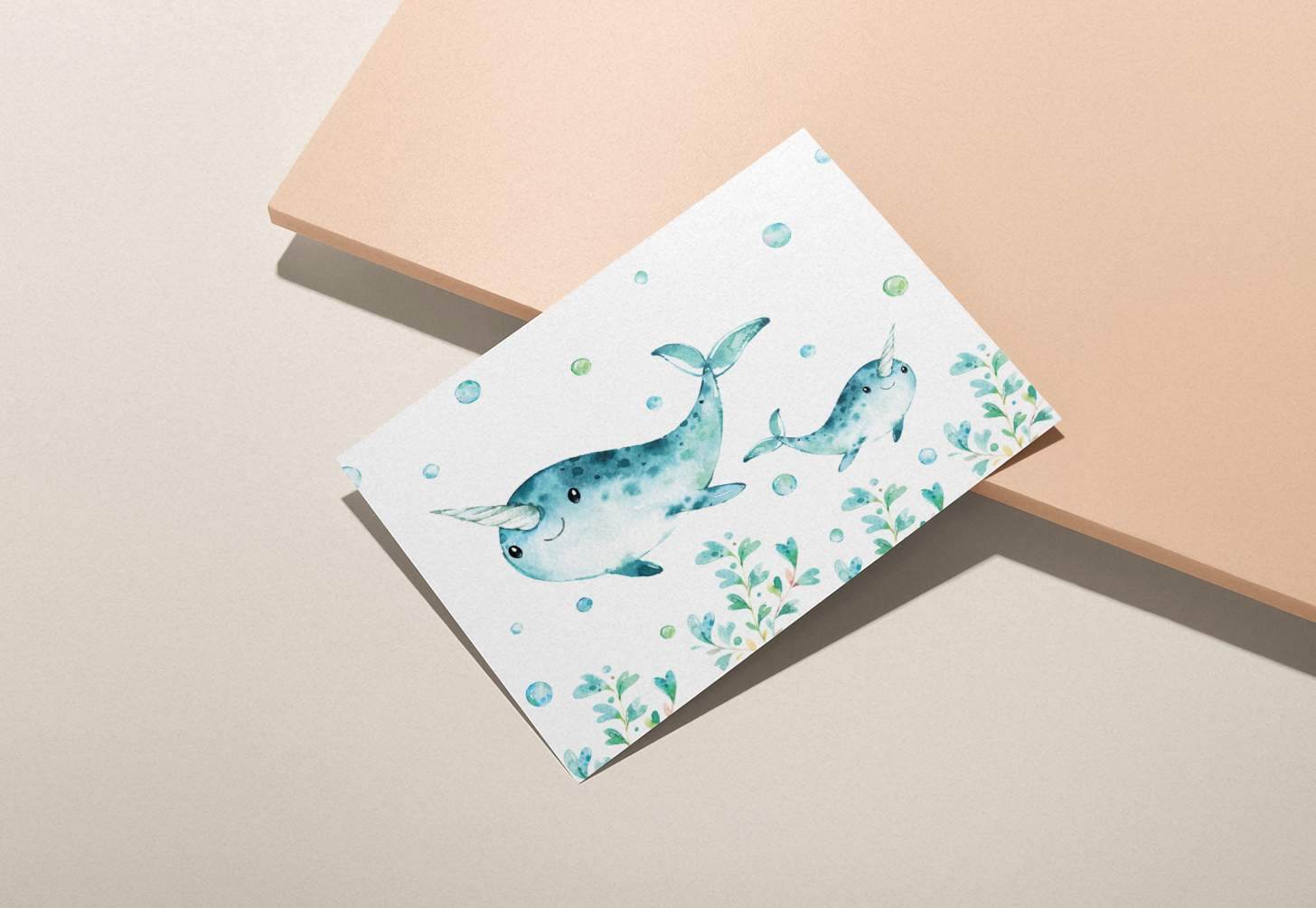 Mother and baby narwhal design with bubbles on a pink background