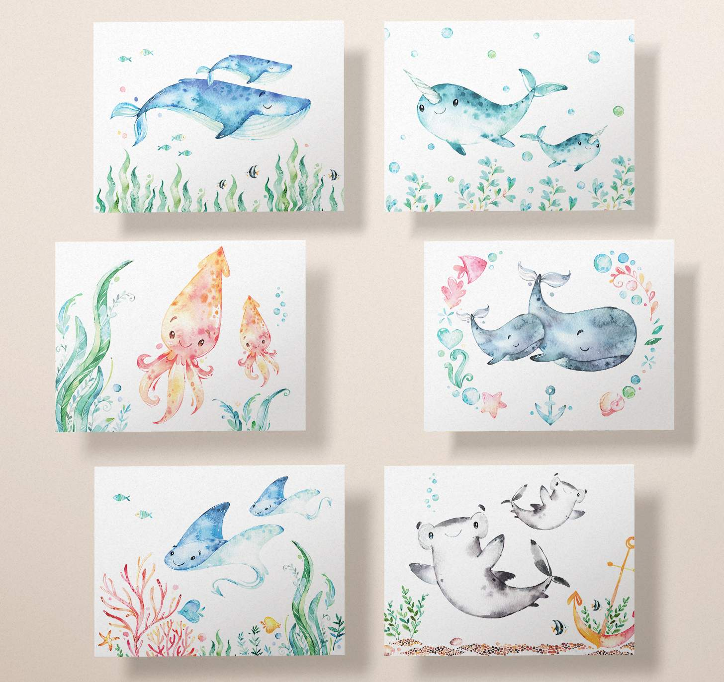 Six cards featuring mother and baby blue whale, gray whale, sting ray, squid, narwhal, and shark designs on a pink background