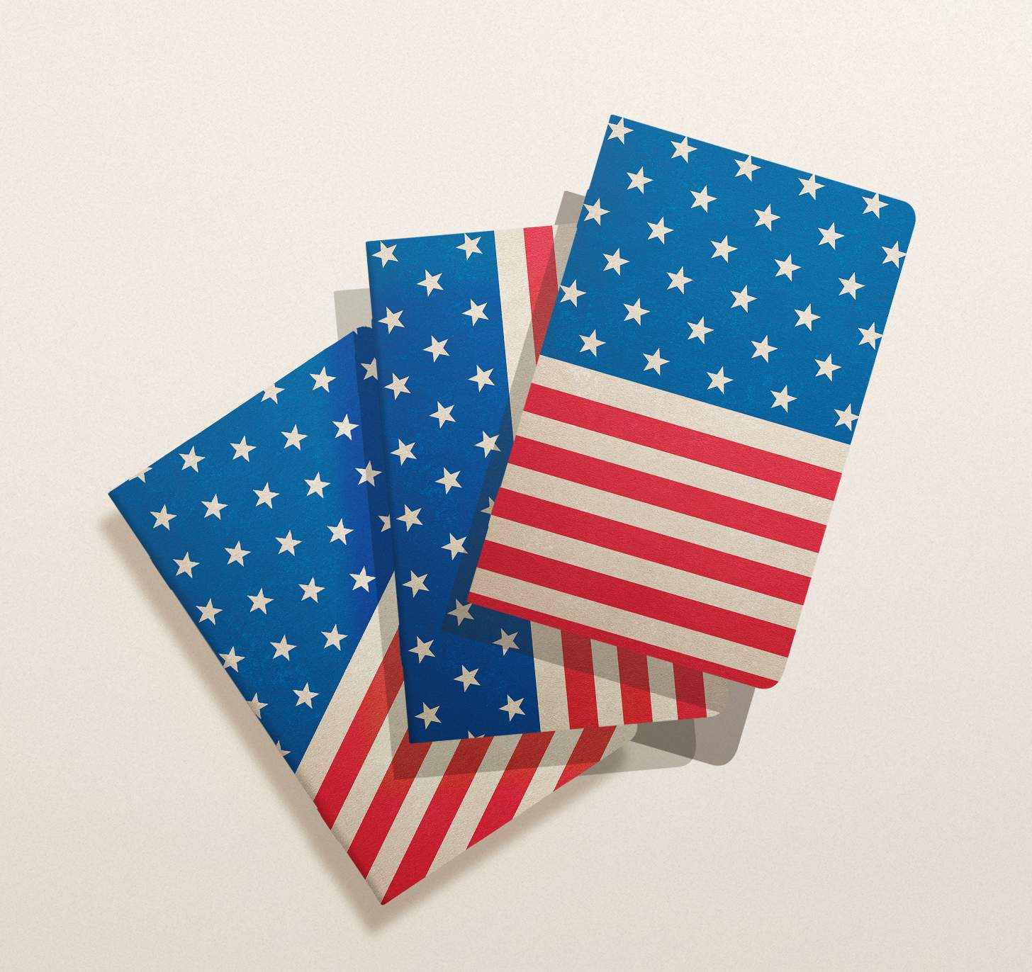 Three overlapping red, white and blue American flag themed notebooks