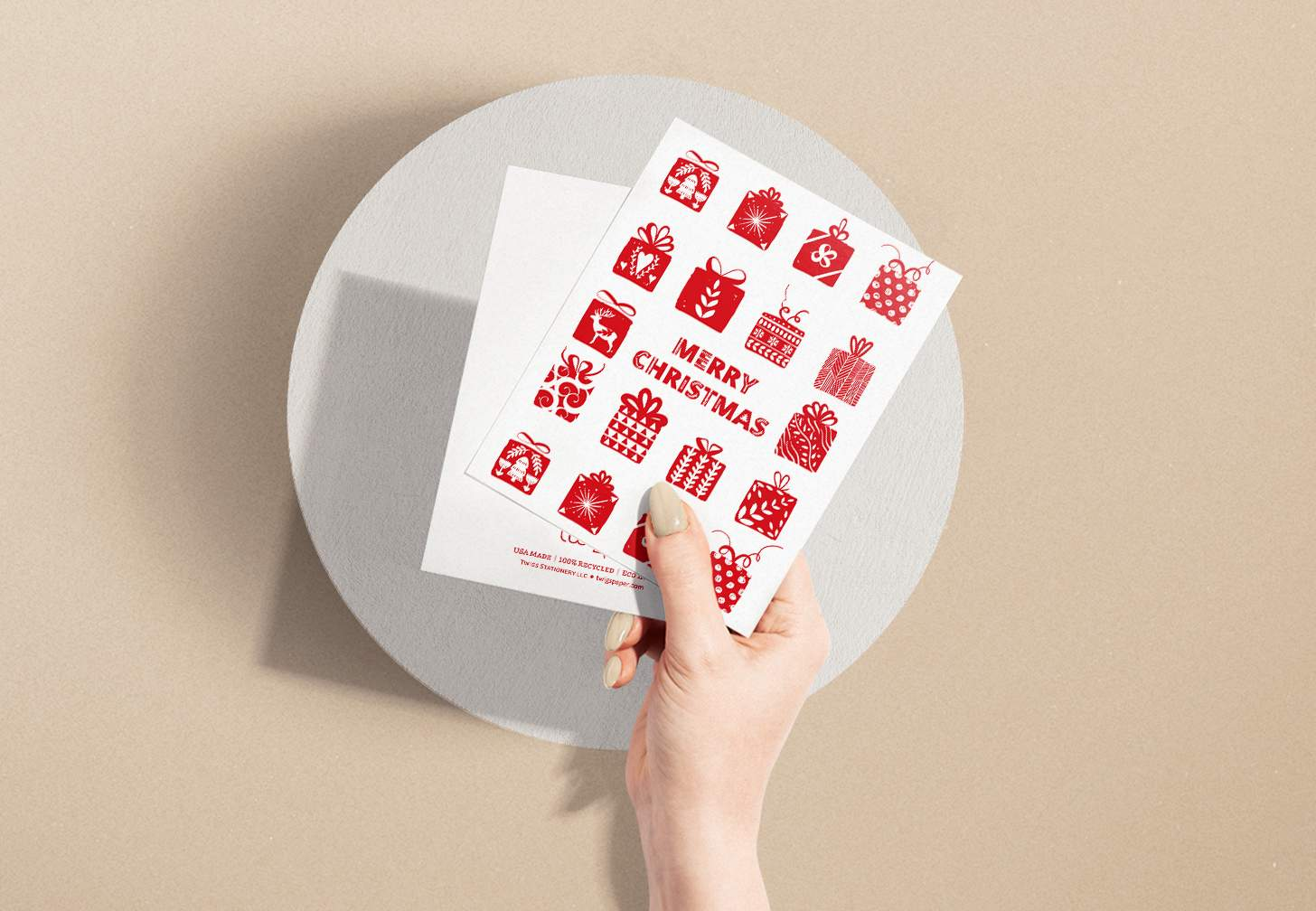 Hands holding Red and white Merry Christmas with presents design