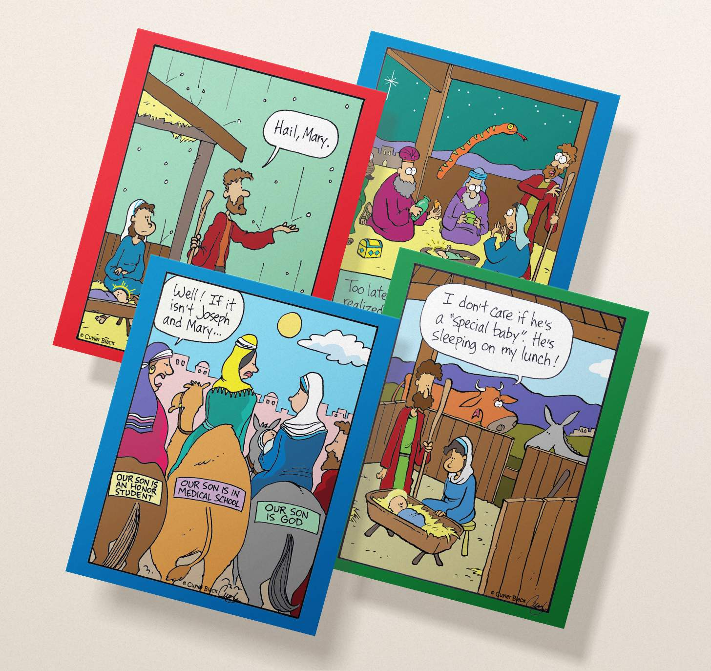Four overlapping assorted Christmas cards with funny religious designs