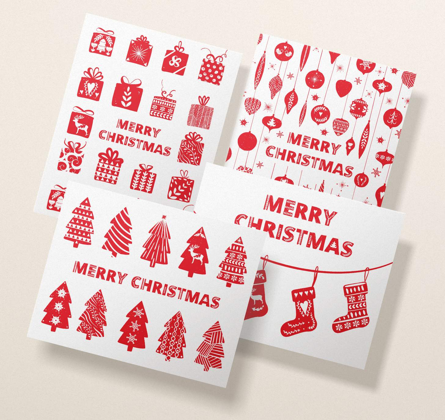 Four overlapping assorted Merry Christmas cards with trees, presents, stockings, and ornaments designs