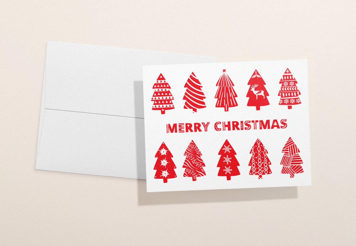 Red and white Christmas card with trees and white envelope