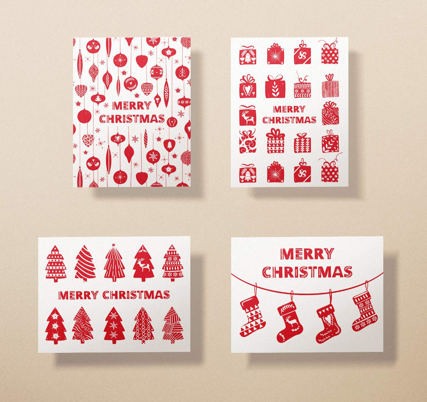 Four assorted merry Christmas cards with trees, presents, stockings, and ornaments designs