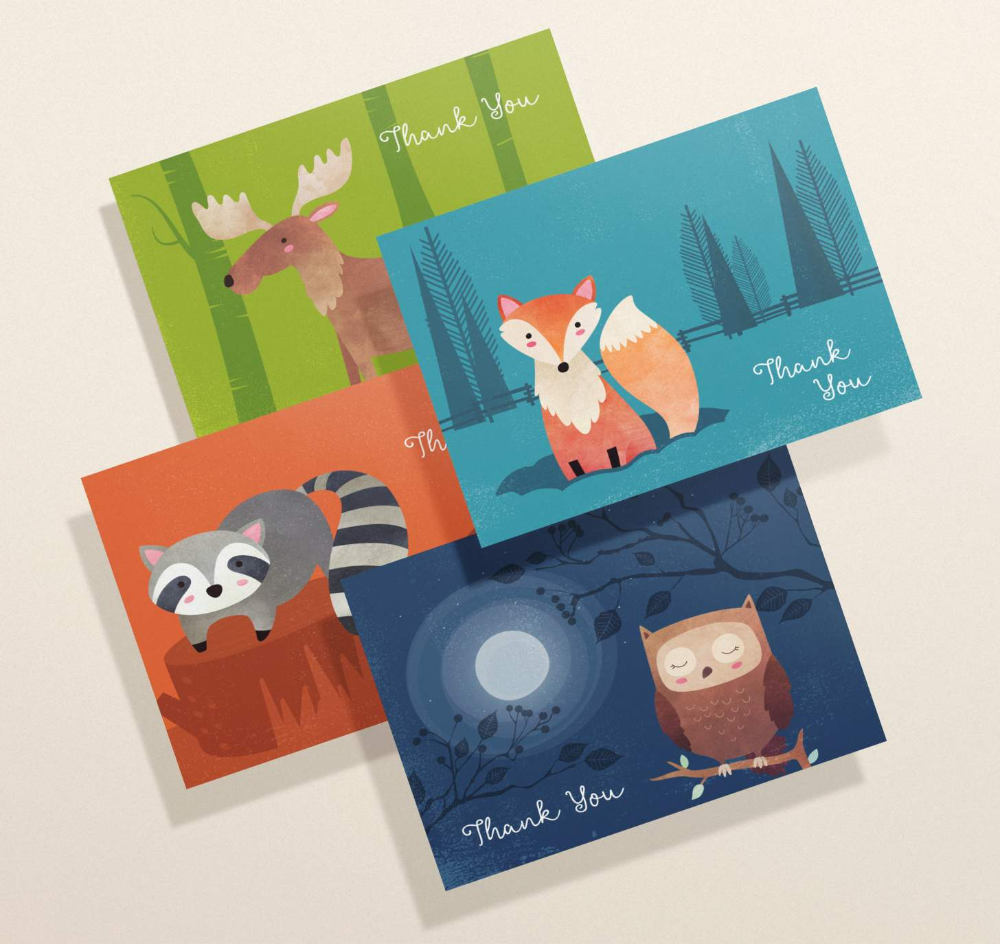 Four overlapping cards with cute owl, raccoon, fox and moose designs