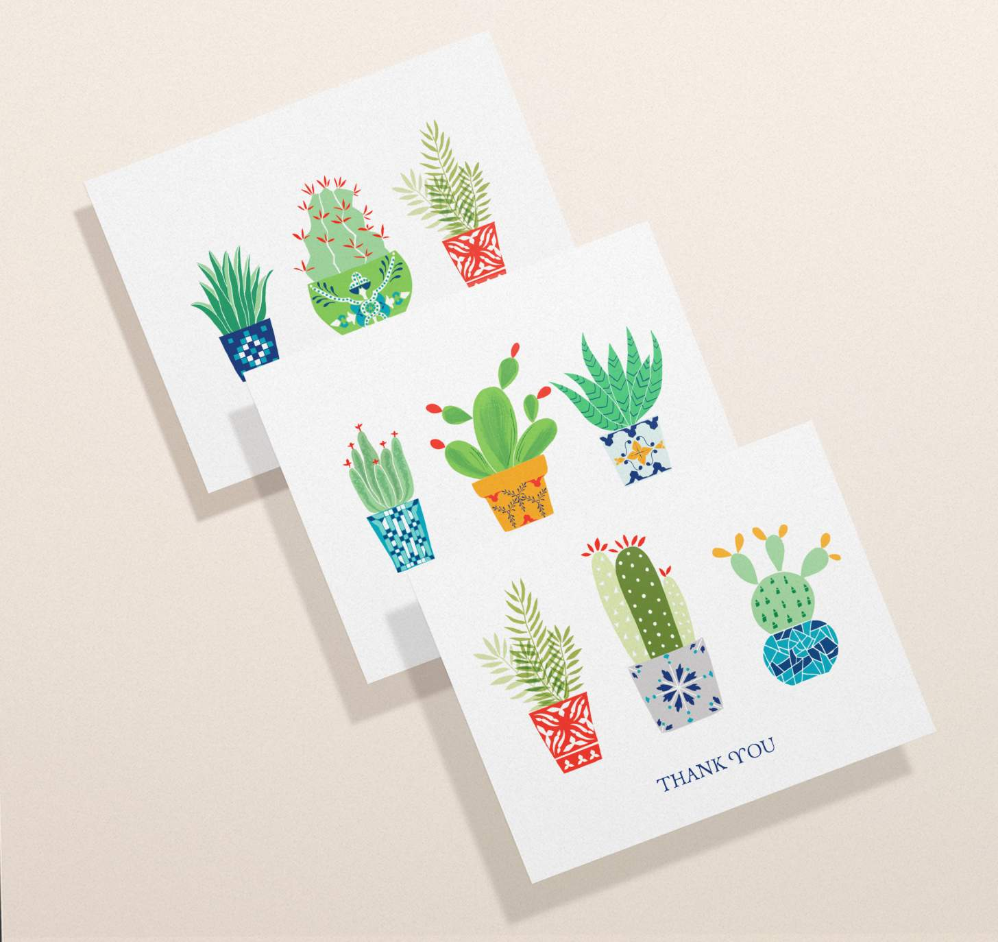 Three overlapping assorted succulent card designs