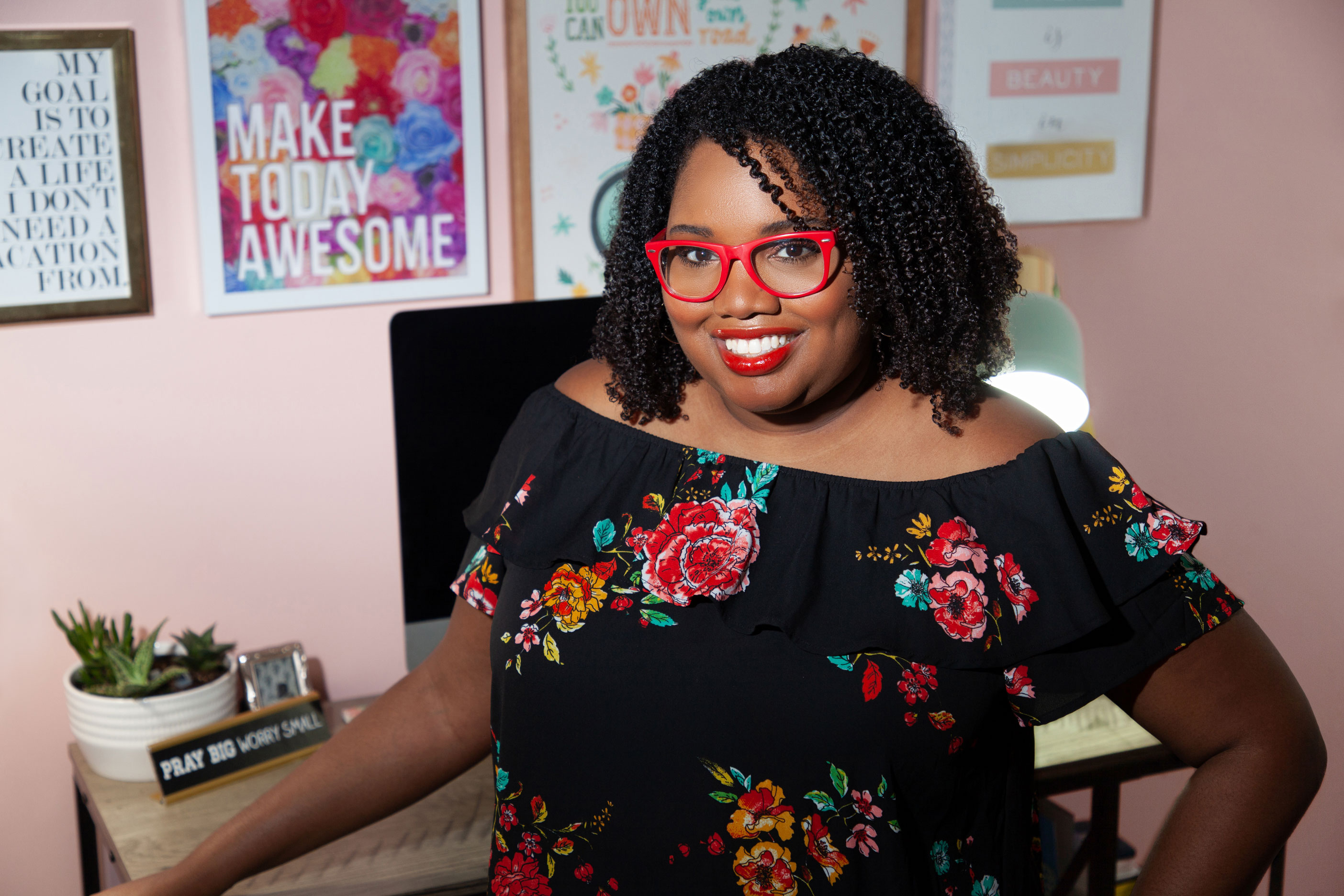 Brand Coach & Strategist, Tiffany Atkinson, is standing in her home office in front of her desk and inspiration wall. | Tiffany Atkinson Consulting | tiffanyatkinson.com