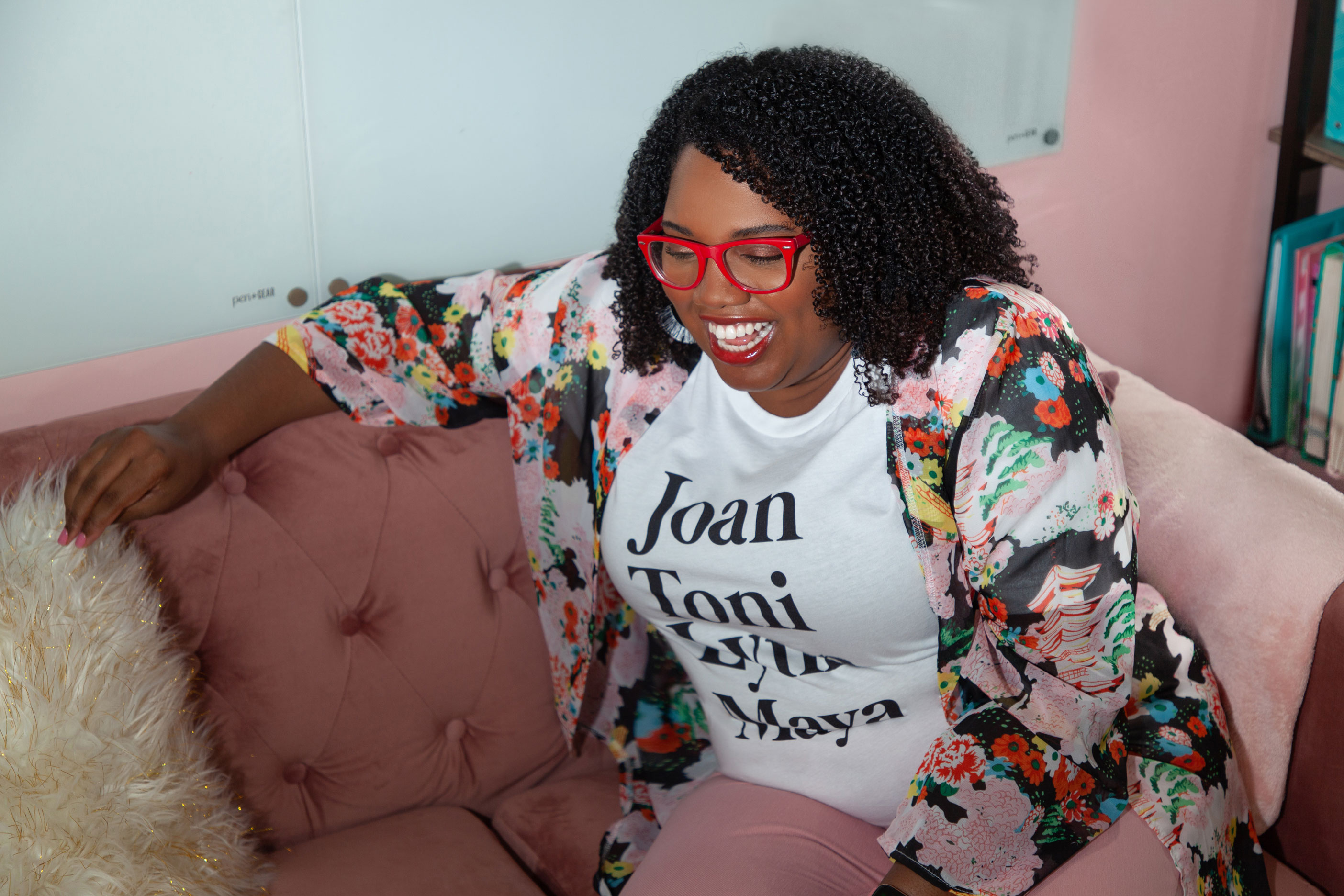Brand Coach & Strategist, Tiffany Atkinson, is sitting on her couch in her home office. | Tiffany Atkinson Consulting | tiffanyatkinson.com