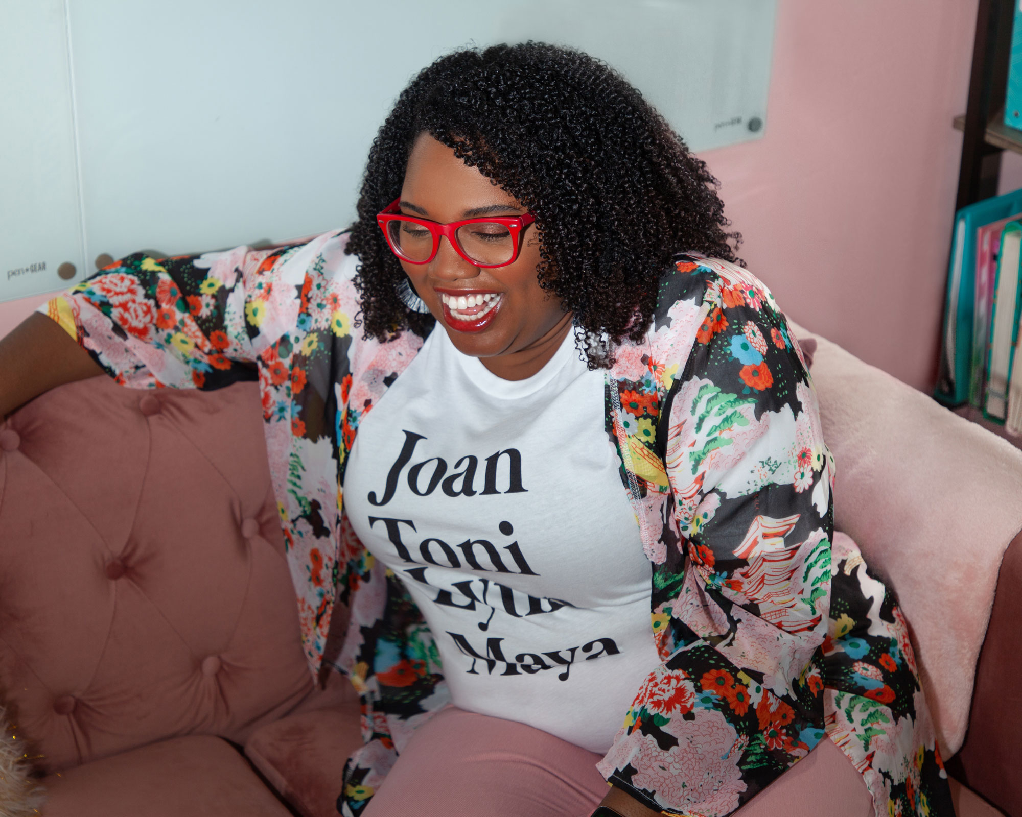 Brand Coach & Strategist, Tiffany Atkinson, is sitting on her couch in her home office.   Tiffany Atkinson Consulting   tiffanyatkinson.com
