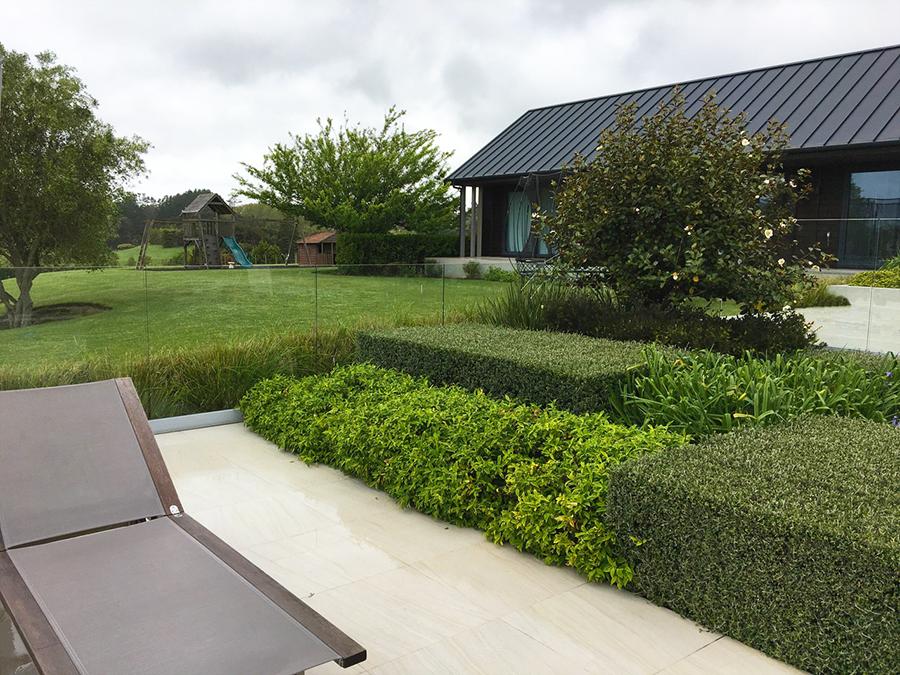 Landscaped box hedging around pool